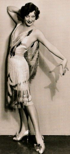 Joan Crawford models a flapper-style evening dress, 1920s