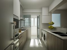 No top cabinets for one side of kitchen: appears more open. Ensure table top is raised at back of sink for easy cleaning