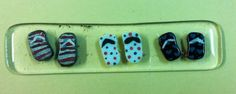 Tiny fused glass flip flops made by middle school student.