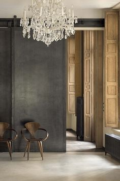 Dark grey wall, chandelier, wood work.  ~UR