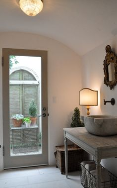 Suzie: Giannetti Home - Gorgeous bathroom with glass door, French gray washed bathroom vanity, ...
