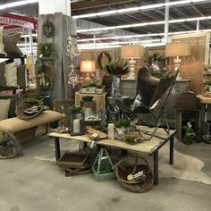 Feb. 2016 Scott Antique Market - South Building K-12 Shipping crate with metal frame coffee tables, cowhide butterfly chairs, lamps, accessories, handmade pillows, lanterns