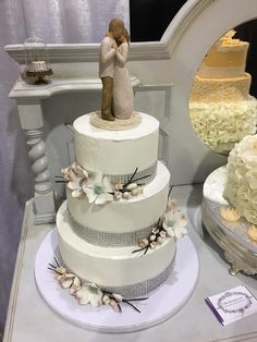 Cakes By Laura, LLC        Wedding cake with gumpaste Dogwood flowers and Willow Tree topper.