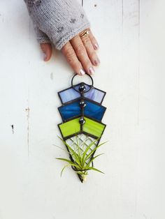 Heres another stained glass panel air plant holder with an art deco design in pretty colors. The geometric pattern is offset by a clear checkered