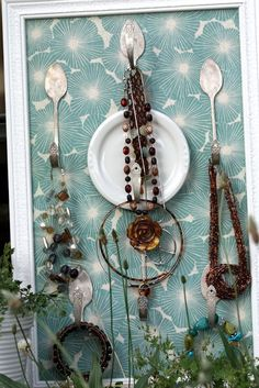 Organizing jewelry. Necklace hanger made from spoons and plates.