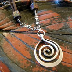 Sterling+silver+spiral+necklace+with+leather+by+coldfeetjewelry