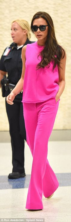 PICTURE EXCLUSIVE: Victoria Beckham stands out in hot pink top and matching flares as she arrives at JFK airport | Daily Mail Online