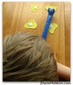Party Blower Fly Catching Game.  Oral motor blowing game with a cool twist and visual incentive.  Visit pinterest.com/arktherapeutic for more #oralmotor therapy ideas