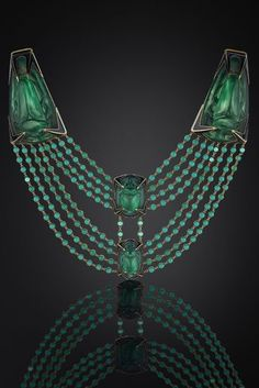 René Lalique - An extraordinary Art Nouveau gold, enamel and moulded glass necklace, Paris, circa 1900. In the Egyptian taste. Contained in its original silk and velvet lined leather Lalique case.