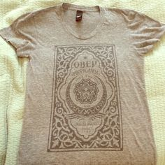 Obey top Grey short sleeve shirt. Worn quite a bit. Great material. Great top. Obey Tops Tees - Short Sleeve