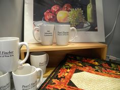 Mugs and other items sold in the museum store.