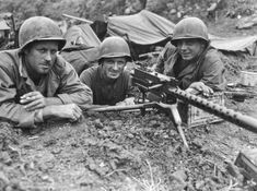 MAY  21 1945 Okinawa – Medal of Honor for Conscientious Objector - See more at: http://ww2today.com/GIs from the 77th Infantry Division man a machine gun nest on the island of Shima, May 3, 1945. The M1919 machine gun was the standard issue for the US Army.