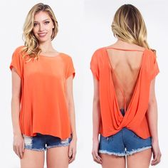 Orange fabulous backdrop top Basic orange cap sleeve top with unique detail on the back. Pair it with jeans and ankle boots for a cool casual ensemble. Pair with our white or black camisole for extra coverage. Looks fabulous both ways. 100% polyester.  Do not purchase this listing message me to create you own. Lewboutiquetwo Tops