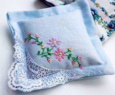 handerchief sachets. A great way to use my grandmothers old hankies.
