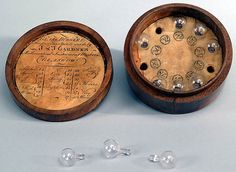 Wine Tester, 18th Century, Made by J & J Gardner, Mathematical Instrument makers, Glasgow. The glass balls were floated on the surface of the wine to determine density. | National Park Service Museum Collections