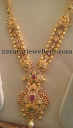 Gold balls and uncut shaped CZ stones, simple rubies and emerald studded triple layers long chain with peacock style classic pendant, ...