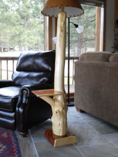 Rustic floor lamp with table made from cedar log.