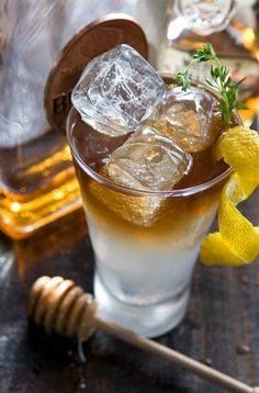 Whiskey-Thyme Lemonade |  1 cup turbinado sugar 1 cup water ~12 sprigs of thyme, plus 2 for garnishes  For the Thyme Simple Syrup  Combine 1 cup turbinado sugar with 1 cup water in a small saucepan over medium heat. Stir until sugar is dissolved and add thyme sprigs.  Simmer for about 10-15 minutes. Let cool.  Strain thyme from the liquid and store in the refrigerator for up to two weeks.