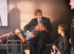 Cradling the Creator from The X-Files Flashback! See Vintage Behind-the-Scenes Photos  David Duchovny and creator Chris Carter on set of The X-Files.