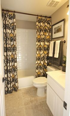 BathroomUse regular curtains and take rod to the ceiling so easy with huge impact! @ DIY House Remodel I love when photos are the same layout of my home. this is exactly our guest bathroom. makes it easier to visualize in my home Extra Long Shower Curtain, Long Shower Curtains, Bathroom Curtains, Bathroom Shelves, Ceiling Curtains, Bathroom Towels, Target Bathroom, Bathroom Windows, Fabric Shower Curtains