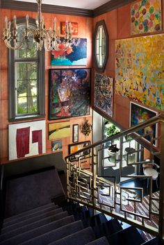 Gallery wall of contemporary art showcased along the walls of a staircase // #kellywearstlerXdomaine