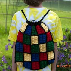 The Lego Inspired Crochet Backpack is a simple pouch with a set of drawstrings that close up the top and double as the straps! Get the free pattern today!