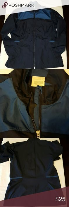 Nike Golf Windbreaker Excellent used condition Nike Golf Windbreaker in size medium (8-10). It is navy with blue accents Nike Jackets & Coats