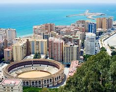 Photo about View of Malaga, Spain with the Plaza de Toros (bullring) in the foreground. Image of malaga, europe, arena - 2841777 Malaga Spain, Alicante Spain, Lonely Planet, Places To Travel, Places To Visit, Travel Destinations, Malaga City, Portugal, Spain Images