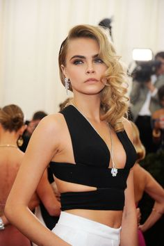 Take to your hairdresser: Side-swept bombshell curls are a red carpet classic but do a Cara and modernise them with a slick texture contrasting the volume on the opposite side. While you could DIY this at home using tongs such as the Ghd Curve, going to a stylist would ensure your curls have a glossy finish that stay bouncy as long as you do. -Cosmopolitan.co.uk