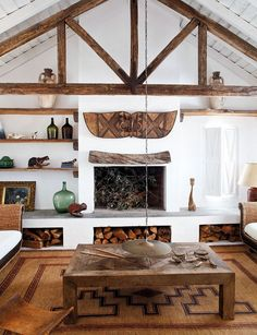 white washed walls and exposed board ceiling, natural exposed wood, doormat esque rug, natural materials, low hanging lamp