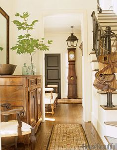All the antique American hooked rugs in this house designed by Barbara Westbrook, including those in this entryway, are from Rubs by Robinson.