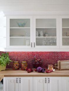 red kitchen backsplash   red tile backsplash adds zing to this happy country kitchen.