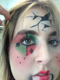 had to do an eye look to do with halloween, i went with a jester idea. i used eyeshdow and water based paints to achieve the look. its not the neatest because we only had 10 minutes to do it