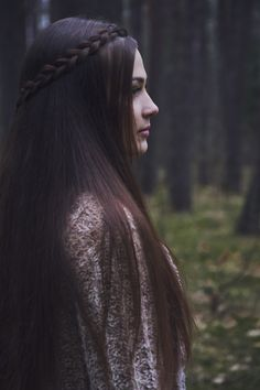 Dark woods by Elixir Photography - Photo Young woman with long brown hair and braids in the forest