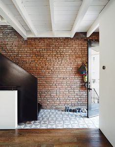 """The """"PUSHmi-PULLyu"""" house is a renovation of a worker's house in Greenpoint for a cre..."""