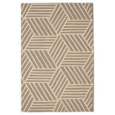 Update your home decor with this sophisticated Contemporary Strata Rug from Nourison. This indoor accent rug features a bold geometric design that creates a 3D look and is made with a wool blend for ultimate durability. This eye-catching accent rug will add a bold touch of style to any room in your home while adding comfort underfoot. Featuring a low pile height that makes for easy cleaning and maintenance, this contemporary geometric accent rug is the perfect way to refresh any space.