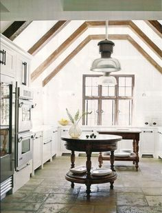One of Kay Douglass' kitchens - love the round tables as islands.