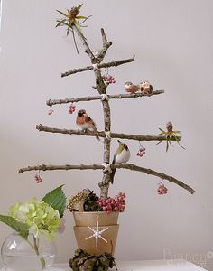 Christmas twig tree! ღ might have to make something similar, love bare branches and birdies! (maybe just a larger more natural arrangement for the table in the corner, tiny birdhouses and pinecone ornaments, birds, little gold or dark gingham bows ... )