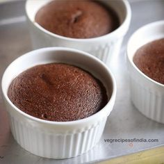 lava cake recipe with video and detailed step by step pics. this is an easy recipe of preparing delicious chocolate lava cake without eggs. the recipe is very simple, fuss free, easy and makes use of whole wheat flour and cocoa powder. Chocolate Trifle Desserts, Eggless Desserts, Eggless Recipes, Eggless Baking, Eggless Muffins, Mini Desserts, Choco Lava Cake Recipe, Eggless Chocolate Cake, Lava Cake Recipes