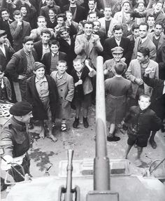 Liberated Athenians greet British soldiers in Athens from the photo book Ellada 1944 by Dmitri Kessel