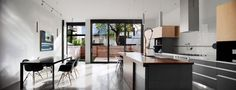 Home Design Kitchen Under Home Among Modern Dining Nook Decorated With Darkwood Table Also Modern Chairs Three Storey Contemporary Dwelling in Stylish Appearance