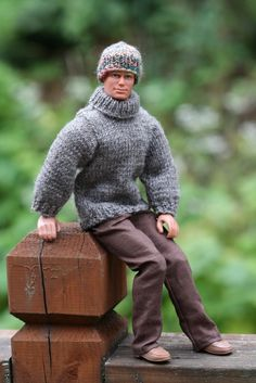 Did some knitting this past weekend.  Still warm out but soon the doll will be wanting warmer clothes.  Owen here is wearing a lovely gray sweater, turtleneck pullover.  He is also wearing a stocking cap in multiple earth tone colors.  I think he wishes it was colder out!!  LOL  SOLD