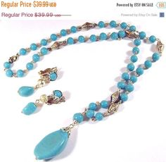 This turquoise aqua art glass #vintage necklace and earring set is truly gorgeous!  It features round glass turquoise beads on a silvertone chain alternating with 3-dimensio... #ecochic #etsy #jewelry #jewellery #holiday2014etfs