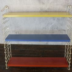 Mid Century Dutch Tomado Book Rack in Yellow Blue and Red