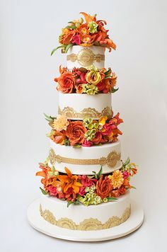 When designing your wedding cake, going for gold is always a fabulous option. This orange and pink design from Ron Ben-Israel is stunning.