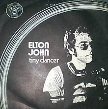 Hold me closer tiny dancer,  Count the headlights on the highway,  Lay me down in sheets of linen,  You had a busy day today (Elton John - Tiny Dancer)
