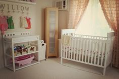 Cute nursery pics...ruffled curtains, hooks for cute little clothes, and a chandelier!