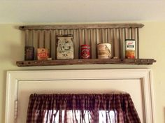 piece of a chicken crate as a shelf for old cans...