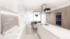 Spanish studio onside took on the refurbishment and interior design of this modern, subtle apartment in the El Ensanche district of Valencia, Spain.