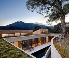 The house is sited to engage the undulating hillside and capture the spectacular views of Mount Tamalpais and the San Francisco Bay.